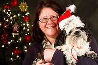 Dogs photographed at a Muttmixer holiday party thrown by City Dog magazine in Seattle, WA on December 09, 2010. (photo by Karen Ducey)Edgar, a Lhasa Apso, and his owner Lisa Irwin are photographed at a Muttmixer holiday party thrown by City Dog magazine in Seattle, WA on December 09, 2010. (photo by Karen Ducey)