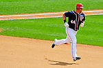 4 July 2009: Washington Nationals outfielder Adam Dunn rounds the bases after hitting his 300th career home against the Atlanta Braves at Nationals Park in Washington, DC. Dunn also hit the game winning RBI single as the Nationals rallied with 4 runs in the 8th inning to defeat the Braves 5-3 and take the second game tying the 3-game weekend series. Mandatory Credit: Ed Wolfstein Photo