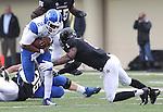 UK quarterback Jalen Whitlow runs the ball during the second half of the University of Kentucky vs. Vanderbilt University football game at Vanderbilt Stadium in Nashville, Tenn., on Saturday, November 16, 2013. Vanderbilt won 22-6. Photo by Tessa Lighty | Staff