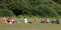 As temperatures hit 82F - the hottest day of the year so far - People relax in Priory Country Park lake as restrictions on forms of exercise are eased during the COVID 19 Lockdown. Priory Park, Bedford. May 20th 2020 <br /> <br /> Photo by Keith Mayhew