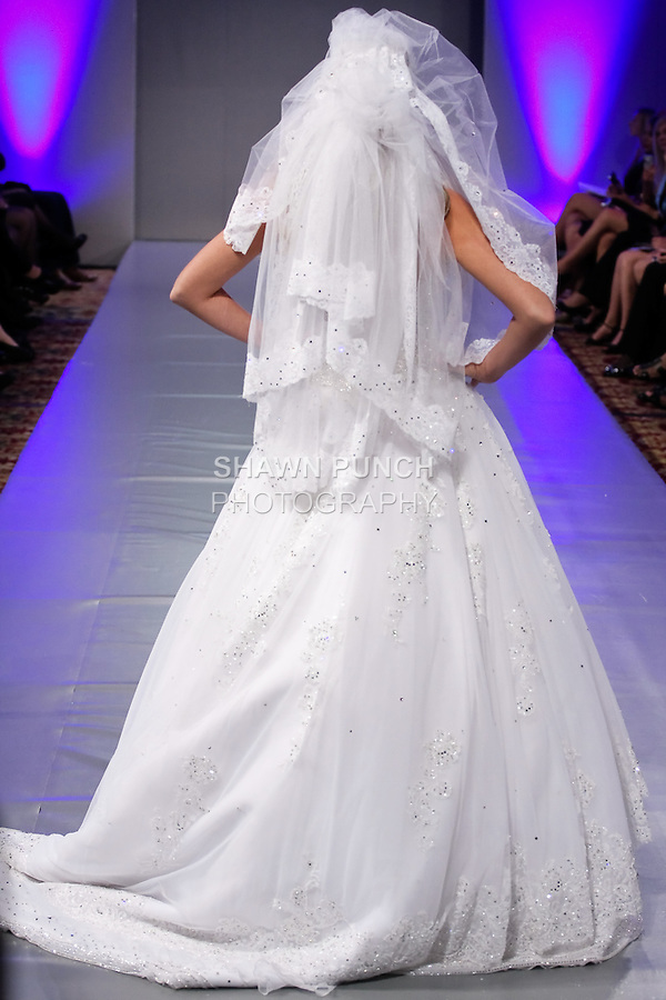 Model walks the runway in an Bridal gown by Lebanese designer Mireille Dagher, for her Mireille Dagher Salon de Couture Spring Summer 2012 collection, during Couture Fashion Week, Spring 2012.