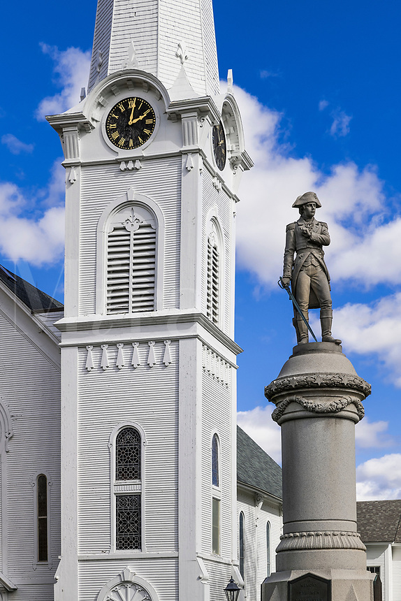 Congregational church clock tower and verterans memorial statue, Manchester, Vermont, USA.