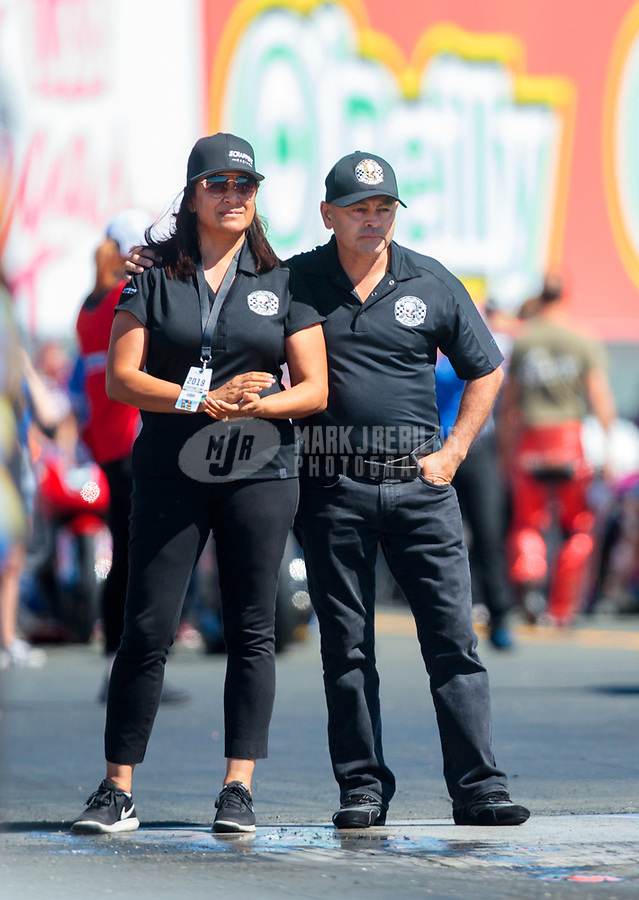 Jul 26, 2019; Sonoma, CA, USA; NHRA top fuel driver Mike Salinas (right) with wife Monica Salinas during qualifying for the Sonoma Nationals at Sonoma Raceway. Mandatory Credit: Mark J. Rebilas-USA TODAY Sports