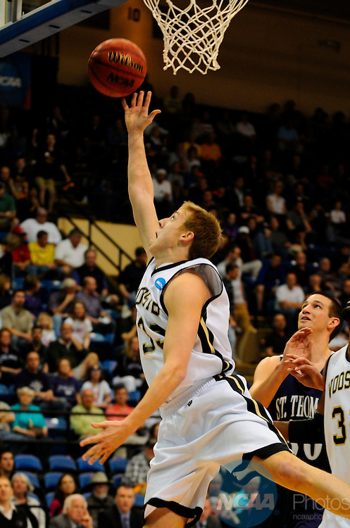 19 MAR 2011: Guard Ian Franks (33) of Wooster drives to the hoop for 2 of his game high 22 points during the Division III Men's Basketball Championship held at the Salem Civic Center in Salem, VA. The University of St. Thomas (Minnesota) defeated College of Wooster 78-54 to win the national title.  Andres Alonso/NCAA Photos