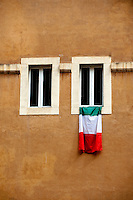 Italian flag hanging from window, Rome, Italy