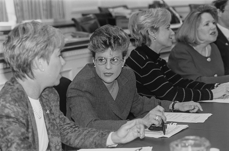 At a family friendly meeting held in Rayburn House Office Building. Rep. Deborah Pryce, R-Ohio, Rep. Ileana Ros-Lehtinen, R-Fla., Janis Berman, wife of Rep. Howard L. Berman, and Becky Weber, Council of Surface Transportation of Subcommittee of Public Works, in November 1994. (Photo by Maureen Keating/CQ Roll Call via Getty Images)