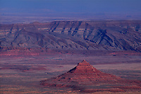 731350080 late afternoon light adds color to the vast high desert sandstone buttes and sandstone formations in cathedral valley in a remote section of capitol reef national park utah