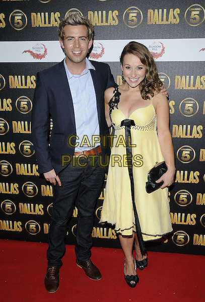 Derek Moran & Jen Pringle.The Channel 5 Launch Party for the new series of 'Dallas', Old Billingsgate Market, London, England..21st August 2012.full length suit shirt blue black yellow dress clutch bag ribbon .CAP/CAN.©Can Nguyen/Capital Pictures.
