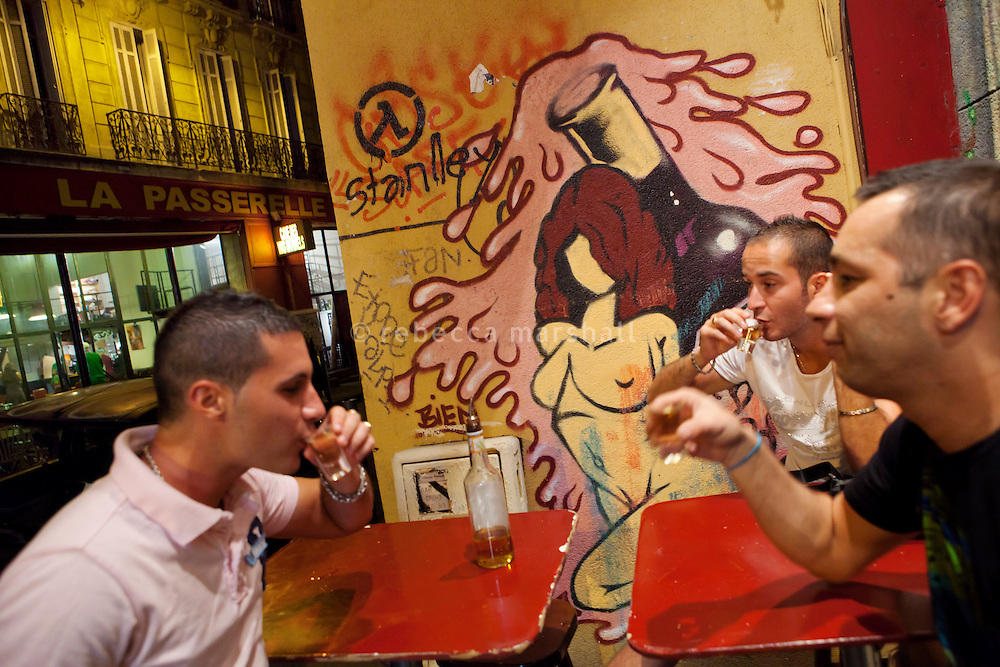 Men drink a toast in a small bar in la Plaine district, Marseille, 16 June 2011