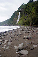 Contemplation at a black sand beach with waterfall in Waipio