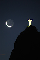 The moon sets near the Christ the Redeemer statue in Rio de Janeiro, Feb. 10, 2005. The statue was built in 1921 atop the 710 meter Corcovado mountain.(AustralFoto/Douglas Engle)