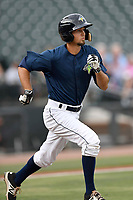 Center fielder Jacob Zanon (21) of the Columbia Fireflies runs toward first in a game against the Charleston RiverDogs on Monday, August 7, 2017, at Spirit Communications Park in Columbia, South Carolina. Columbia won, 6-4. (Tom Priddy/Four Seam Images)