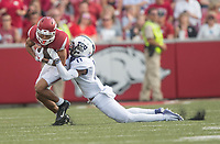 NWA Democrat-Gazette/J.T. WAMPLER Arkansas' Deon Stewart gets dragged down by TCU's Ranthony Texada Saturday Sept. 9, 2017 at Donald W. Reynolds Razorback Stadium in Fayetteville. Arkansas lost 28-7.