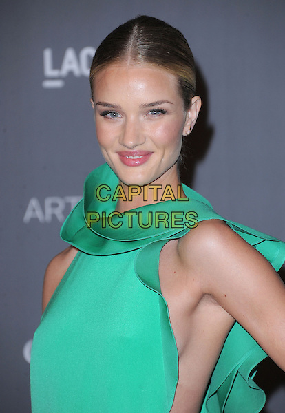 Rosie Huntington-Whiteley.at The LACMA 2012 Art and Film Gala held at LACMA in Los Angeles, California, USA, October 27th 2012..portrait headshot green sleeveless high neck folded smiling .CAP/RKE/DVS.©DVS/RockinExposures/Capital Pictures.