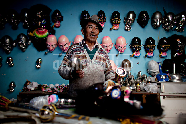 Don Benito, mask maker in his workshop.Just 25 years ago it was a small group of houses around La Paz  airport, at an altitude of 12,000 feet. Now El Alto city  has  nearly one million people, surpassing even the capital of Bolivia, and it is the city of Latin America that grew faster .<br /> It is also a paradigmatic city of the troubles  and traumas of the country. There got refugee thousands of miners that lost  their jobs in 90 ´s after the privatization and closure of many mines. The peasants expelled by the lack of land or low prices for their production. Also many who did not want to live in regions where coca  growers and the Army  faced with violence.<br /> In short, anyone who did not have anything at all and was looking for a place to survive ended up in El Alto.<br /> Today is an amazing city. Not only for its size. Also by showing how its inhabitants,the poorest of the poor in one of the poorest countries in Latin America, managed to get into society, to get some economic development, to replace their firs  cardboard houses with  new ones made with bricks ,  to trace its streets,  to raise their clubs, churches and schools for their children.<br /> Better or worse, some have managed to become a sort of middle class, a section of the society that sociologists call  emerging sectors. Many, maybe  most of them, remain for statistics as  poor. But clearly  all of them have the feeling they got  for their children a better life than the one they had to face themselves .