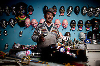 Don Benito, mask maker in his workshop.Just 25 years ago it was a small group of houses around La Paz  airport, at an altitude of 12,000 feet. Now El Alto city  has  nearly one million people, surpassing even the capital of Bolivia, and it is the city of Latin America that grew faster .<br /> 	It is also a paradigmatic city of the troubles  and traumas of the country. There got refugee thousands of miners that lost  their jobs in 90 &acute;s after the privatization and closure of many mines. The peasants expelled by the lack of land or low prices for their production. Also many who did not want to live in regions where coca  growers and the Army  faced with violence.<br /> 	In short, anyone who did not have anything at all and was looking for a place to survive ended up in El Alto.<br /> 	Today is an amazing city. Not only for its size. Also by showing how its inhabitants,the poorest of the poor in one of the poorest countries in Latin America, managed to get into society, to get some economic development, to replace their firs  cardboard houses with  new ones made with bricks ,  to trace its streets,  to raise their clubs, churches and schools for their children.<br /> 	Better or worse, some have managed to become a sort of middle class, a section of the society that sociologists call  emerging sectors. Many, maybe  most of them, remain for statistics as  poor. But clearly  all of them have the feeling they got  for their children a better life than the one they had to face themselves .