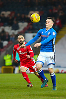 Rochdale's Ollie Rathbone (right) is watched by Walsall's Erhun Oztumer (left) during the Sky Bet League 1 match between Rochdale and Walsall at Spotland Stadium, Rochdale, England on 23 December 2017. Photo by Juel Miah / PRiME Media Images.