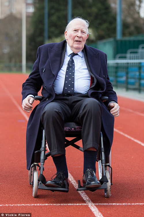 Sir Roger Bannister on the athletics track for a photocall at Paddington Recreation Ground in London on February 26th 2014. The track at Paddington Recreation ground was where Sir Roger Bannister trained for his record sub four minute mile attempt. Today marks the launch of the 2014 Bupa Westminster Mile to be held in May 2014, which will officially celebrate the 60th anniversary.