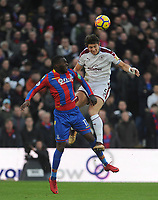 Burnley's James Tarkowski vies for possession with Crystal Palace's Christian Benteke<br /> <br /> Photographer Ashley Crowden/CameraSport<br /> <br /> The Premier League - Crystal Palace v Burnley - Saturday 13th January 2018 - Selhurst Park - London<br /> <br /> World Copyright &copy; 2018 CameraSport. All rights reserved. 43 Linden Ave. Countesthorpe. Leicester. England. LE8 5PG - Tel: +44 (0) 116 277 4147 - admin@camerasport.com - www.camerasport.com