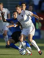 12 June 2004: MetroStars Mark Lisi fights for the ball against Earthquakes Ramiro Corrales at Spartan Stadium in San Jose, California.    Earthquakes defeated MetroStars, 3-1.  Mandatory Credit: Michael Pimentel / ISI