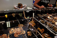 "Reptile shows are full of exotic snakes for sale. The pet industry is largely responsible for the introduction of exotic pets into our enivornment. The US dominates both import and export in the booming reptile trade. More than 2.5 million reptiles are brought in annually. Enough are released ""into the wild"" when they become too large or require too much of an owners time, that feral colonies of green lizards, boa constrictors, cane toads <br /> and 32 exotic species have set up housekeeping in Florida. In turn, Florida ships out 9.5 million reptiles including 8.5 million red-eared slider turtles from the farms and swamps of Louisiana. They are exported for food sources in Asia, but are now illegal. There are few <br /> controls of what can be imported--you can buy about anything--22 of 24 species of pythons as available. Boas, crocodiles, iguanas, bird-eating spiders."