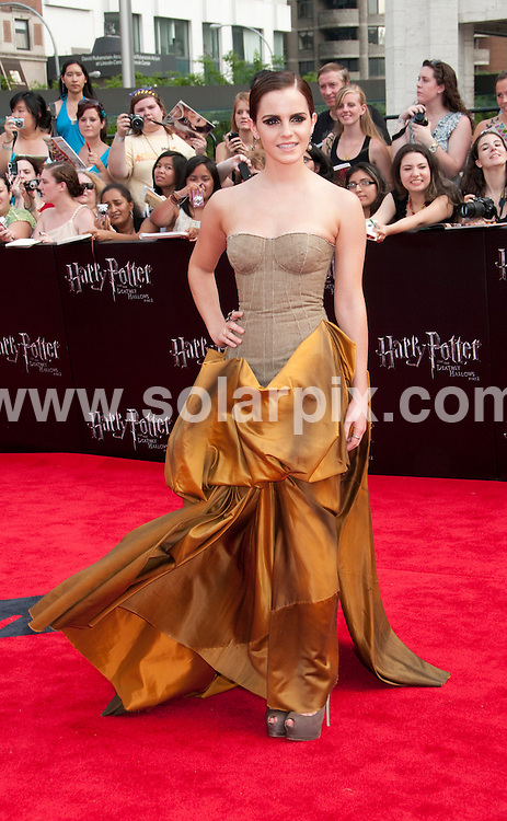 **ALL ROUND PICTURES FROM SOLARPIX.COM**                                             **UK SYNDICATION RIGHTS ONLY**    .Caption: New York premiere of Harry Potter And The Deathly Hallows: Part 2. Held at the Avery Fisher Hall, Lincoln Center, New York , USA. July 11, 2011.                                                                         This pic: Emma Watson                                                                                          JOB REF: 13693 RHB       DATE: 11_07_2011                                                           **MUST CREDIT SOLARPIX.COM OR DOUBLE FEE WILL BE CHARGED**                                                                      **MUST AGREE FEE BEFORE ONLINE USAGE**                               **CALL US ON: +34 952 811 768 or LOW RATE FROM UK 0844 617 7637**
