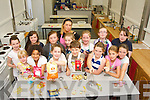 Pictured attending the Kids Summer Baking Camp at Collis Sandes House on Friday. Pictured with instructor Amy Brick were, front row, l-r: Cathy Dwyer, Karina Sheehan, Laura Fitzgerald, Cian Morgan, Rachel Godley, Rachel Hannafin, Jennifer Hannafin. Back row, l-r: Jesse Tierney, Eodhain Fox, Mairead Kearney, Laura Harty, Maria Dwyer, Ciara Kerin and Ciara Fitzgerald..