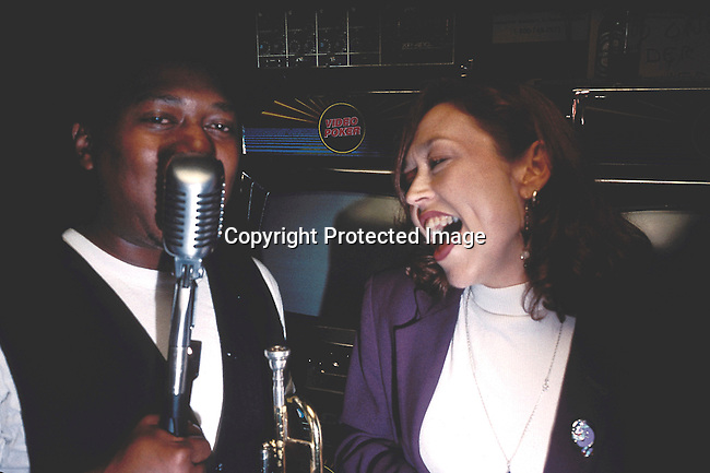 COAMENO35072.Country. America. New Orleans. Man and woman singing over a antique microphone. .©Per-Anders Pettersson / iAfrika Photos