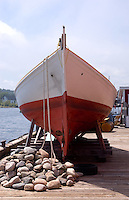 An dory on the dock at the fisherman's museum Lunenburg Nova Scotia Canada North America