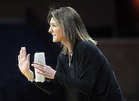 Virginia head coach Joanne Boyle calls a play during the game Thursday in Charlottesville, VA. Photo/The Daily Progress/Andrew Shurtleff
