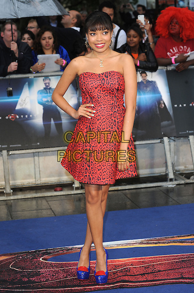 Dionne Bromfield <br /> 'Man Of Steel' UK film premiere, Empire cinema, Leicester Square, London, England.<br /> 12th June 2013<br /> full length red strapless black leopard print dress blue yellow heel shoes hand on hip <br /> CAP/BEL<br /> &copy;Tom Belcher/Capital Pictures