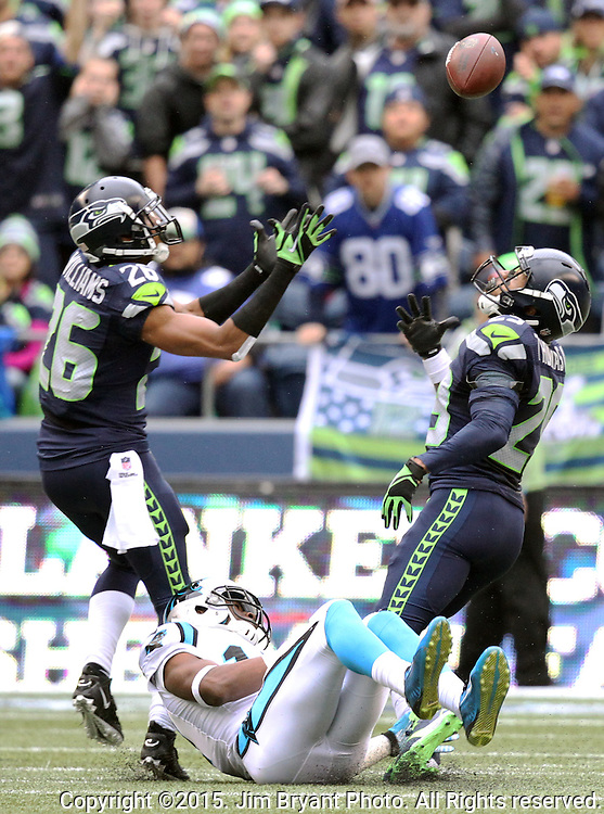 Seattle Seahawks cornerback Cary Williams (26) and safety Earl Thomas (29) defends against Carolina Panthers wide receiver Devin Funchess (17) at CenturyLink Field in Seattle on October 18, 2015. The Panthers came from behind with 32 seconds remaining in the 4th Quarter to beat the Seahawks 27-23.  ©2015 Jim Bryant Photography. All Rights Reserved.