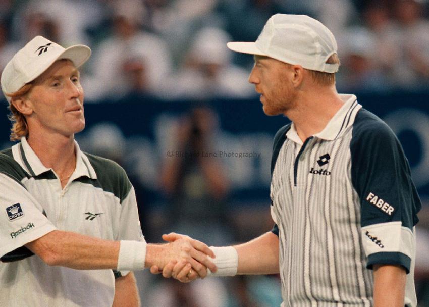 Photo. Abbey Wells.Austrailan Open, Melbourne, Austraila, 1996..Boris Becker (rt) shakes hands with Mark Woodforde