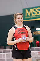 Central Missouri senior Kayla Muyskens stands atop the awards stand with her gold medal after winning the shot put at the 2012 MIAA Indoor Track & Field Championships at Missouri Southern in Joplin, February 26. Muyskens throw of 49-9.75 not only won the competition but was an automatic qualifying mark for the indoor national championships.
