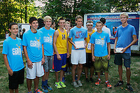 The Francis Howell Vikings show off their 2nd place trophy from the Varsity Boys race at the Fleet Feet Cross Country Kickoff meet at Quail Ridge Park in Wentzville.