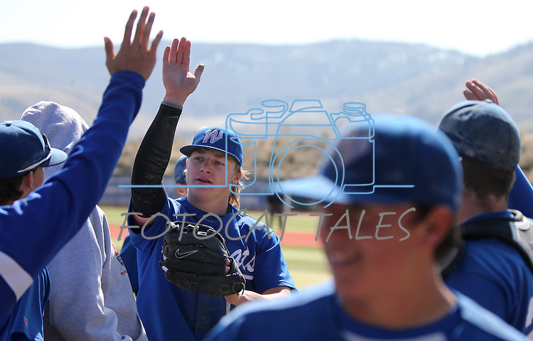Western Nevada's Conor Harber gets greeated in the dugout after making a diving catch in a college baseball game against Southern Nevada in Carson City, Nev., on Friday, March 22, 2013..Photo by Cathleen Allison