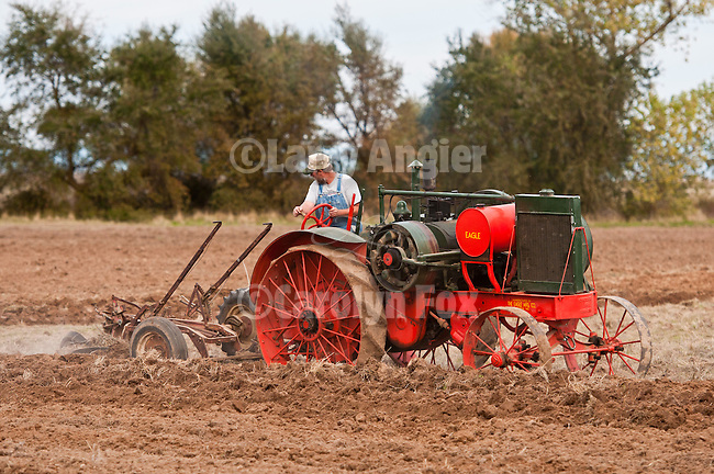 Antique tractors plowing a field in fall during the Branch 158 EDGE & TA Fall Plow Day and Plowing Seminar near Pleasant Grove, Calif...Silmer Scheidel Farm..Jeff Wasllom's 1927 Eagle Mod. H Tractor, 16-30 hp, pulling 2-bottom plow