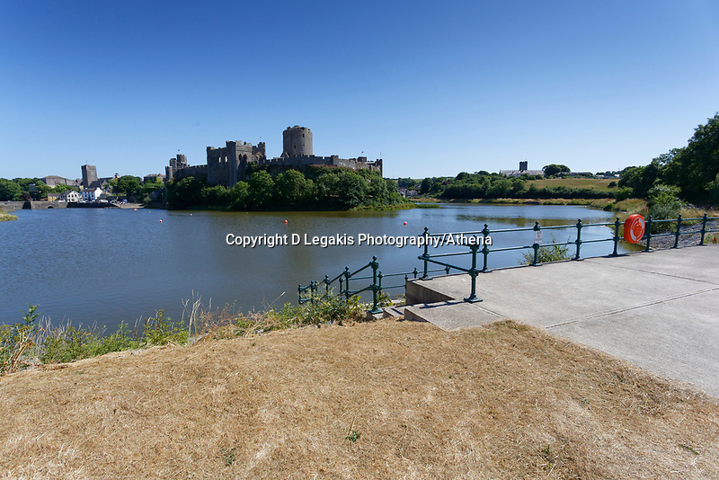 """Pictured: The weir in the pond where killer swan, named by locals """"Mr Nasty"""" has chased other swans from by Pembroke Castle, west Wales, UK. Sunday 08 July 2018<br /> Re: A vicious killer swan is prowling around Pembroke, determined to see off any threat to his territory by ruthlessly drowning his victims.<br /> So far, he has killed 10 other swans, though many more have been saved from his attacks.<br /> Dubbed by locals """"Mr Nasty""""  lives on the Castle Pond by Pembroke Castle. <br /> Bird sanctuary worker Maria Evans says she has watched him at work, drowning other swans, breaking their feet or pushing them over a sluice.<br /> In 2010, another killer swan dubbed """"Hannibal"""" had his wings clipped after attacking other swans in the same pond."""