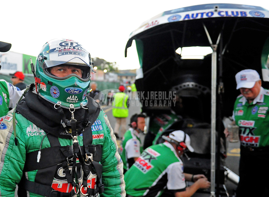 Jul. 24, 2009; Sonoma, CA, USA; NHRA funny car driver John Force during qualifying for the Fram Autolite Nationals at Infineon Raceway. Mandatory Credit: Mark J. Rebilas-