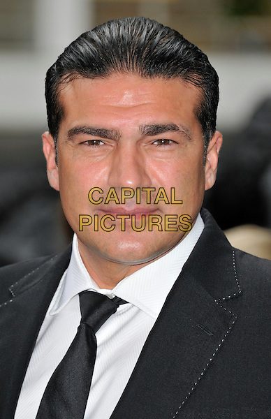 Tamer Hassan.'The Dark Knight Rises' European premiere at Odeon Leicester Square cinema, London, England..18th July 2012.headshot portrait black suit white shirt tie  .CAP/WIZ.© Wizard/Capital Pictures.