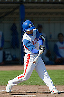 14 September 2009: Left fielder Hun-Gon Kim of South Korea makes contact during the 2009 Baseball World Cup Group F second round match game won 15-5 by South Korea over Great Britain, in the Dutch city of Amsterdan, Netherlands.