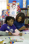 First lady Michelle Obama participates in a literacy service project at the Boys & Girls Club of Greater Washington, DC in celebration of the Martin Luther King, Jr. Day of Service, in Washington, D.C., Monday, January 19, 2015.<br /> Credit: Martin H. Simon / Pool via CNP