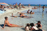 "Spain. Ibiza in the Balearic islands. Ibiza. Mediterranean sea. Beach "" Salines"". Tourists take a rest and sunbathe on a sandy beach. © 1999 Didier Ruef"