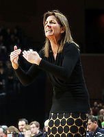 Virginia head coach Joanne Boyle reacts to a call during the first half of an NCAA basketball game against Notre Dame Sunday Jan. 12, 2014 in Charlottesville, VA. (Photo/The Daily Progress/Andrew Shurtleff)