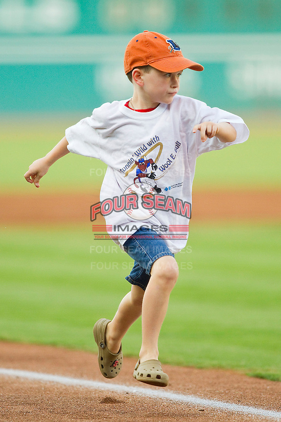 A young fan runs the bases as he races the Durham Bulls mascot between innings of the International League game between the Gwinnett Braves and the Durham Bulls at Durham Bulls Athletic Park on July 27, 2011 in Durham, North Carolina.  The Bulls defeated the Braves 4-0.   (Brian Westerholt / Four Seam Images)