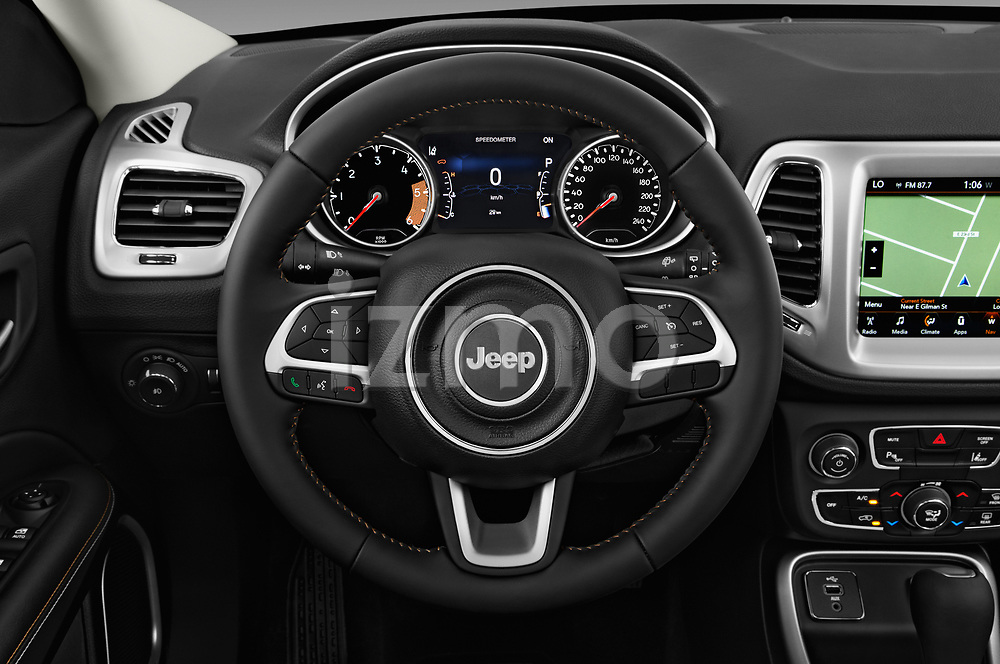 Car pictures of steering wheel view of a 2017 Jeep Compass Latitude 5 Door SUV