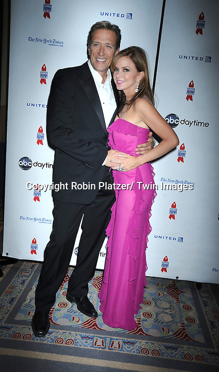 "Walt Willey and Bobbie Eakes posing for photographers at The ABC Daytime Salutes Broadway Cares/ Equity Fights Aids "" An Evening of Musical Entertainment and Comedy""  Benefit after party  on March 13, 2011 at the Marriott Marquis Hotel in New York City."