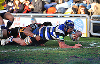 Leroy Houston reaches for the try-line. Amlin Challenge Cup match, between Newport Gwent Dragons and Bath Rugby on January 11, 2014 at Rodney Parade in Newport, Wales. Photo by: Patrick Khachfe / Onside Images