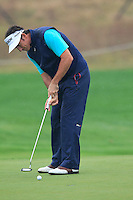 Gonzalo Fernandez-Castano (ESP) putts on the 1st green during Thursday's Round 1 of the 2014 BMW Masters held at Lake Malaren, Shanghai, China 30th October 2014.<br /> Picture: Eoin Clarke www.golffile.ie