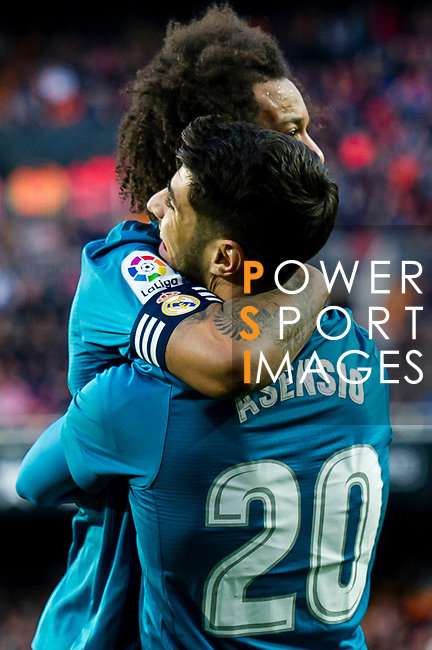 Marcelo Vieira Da Silva of Real Madrid (back) celebrates after scoring his goal with Marco Asensio Willemsen of Real Madrid (front) during the La Liga 2017-18 match between Valencia CF and Real Madrid at Estadio de Mestalla  on 27 January 2018 in Valencia, Spain. Photo by Maria Jose Segovia Carmona / Power Sport Images